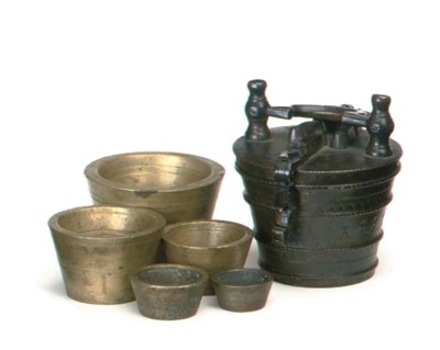 A SET OF CONTINENTAL BRASS CUP