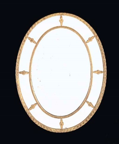 A VICTORIAN GILTWOOD OVAL WALL