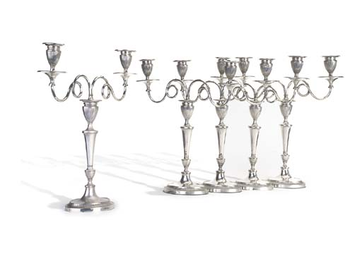 A SET OF FIVE SILVER-PLATED ME