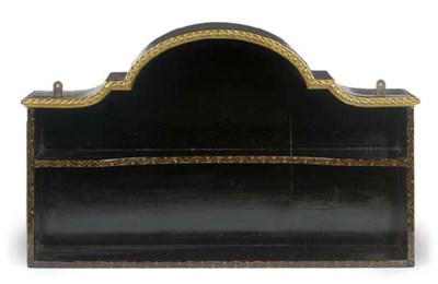 A BRASS-MOUNTED BLACK AND GILT
