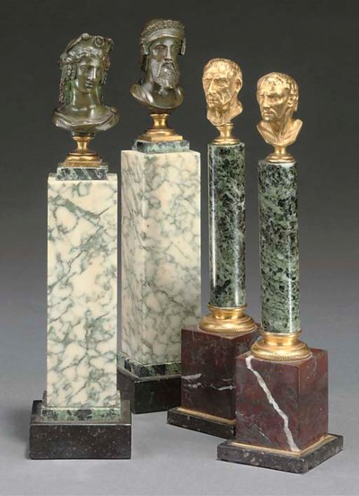A PAIR OF BRONZE BUSTS