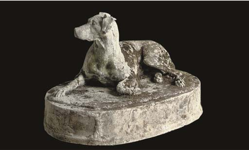 A French stone figure of a dog