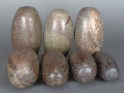 A GROUP OF SEVEN SHIVA LINGUM