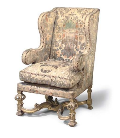 A GILTWOOD WING ARMCHAIR