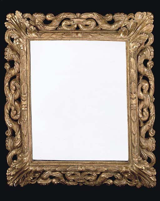 A CARVED GILTWOOD PICTURE FRAM