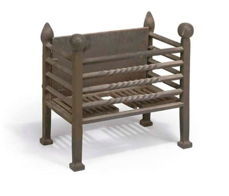 A WROUGHT-IRON FIREGRATE WITH