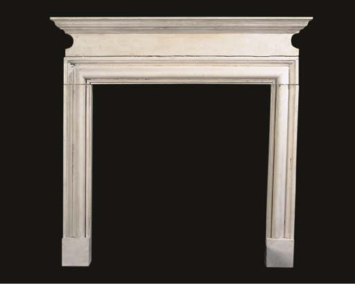 A PAINTED STONE CHIMNEYPIECE