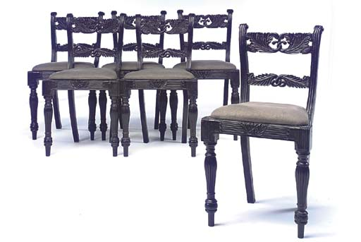 A SET OF SIX EBONY DINING CHAI