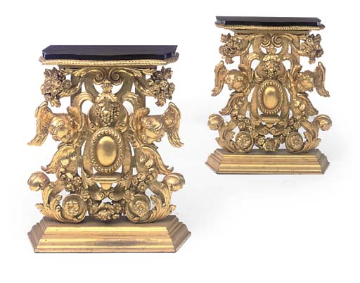 A PAIR OF CARVED GILTWOOD CONS