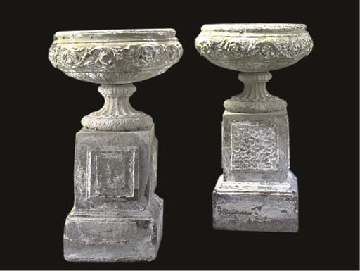 A PAIR OF ARTIFICAL STONE URNS