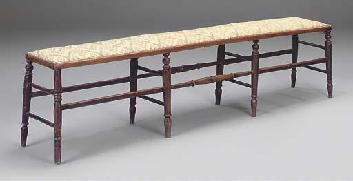 A beechwood padded long stool