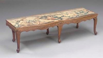 An Italian carved beech table