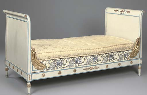 A painted and gilt decorated l