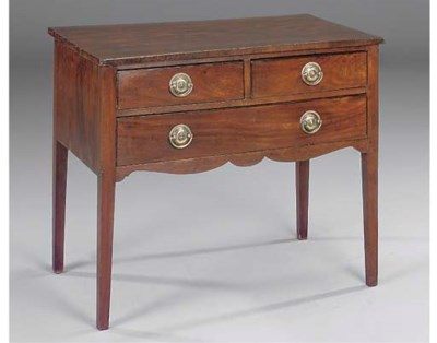 A MAHOGANY AND EBONISED LOWBOY