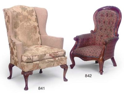 A FLORAL UPHOLSTERED WING ARMC