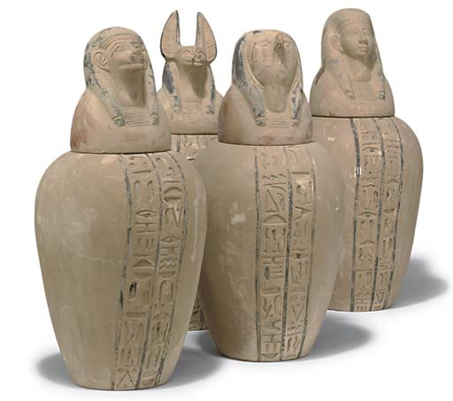 A SET OF FOUR TERRACOTTA CANOP