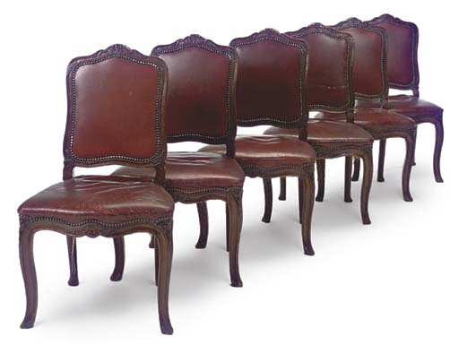 A SET OF SIX WALNUT AND RED-LE