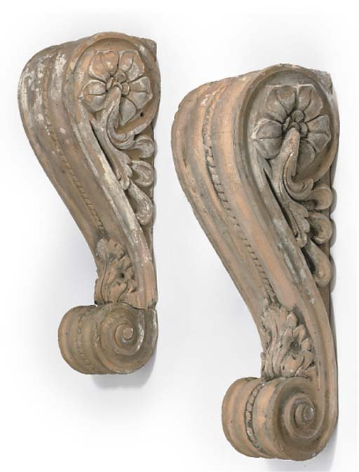 A PAIR OF TERRACOTTA CORBELS
