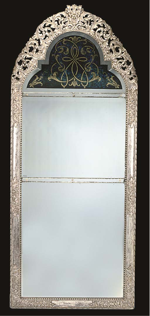 A LARGE SILVERED MIRROR