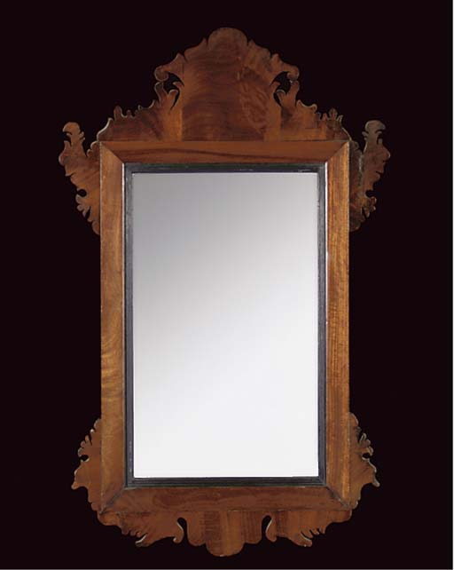 A MAHOGANY FRET CARVED MIRROR