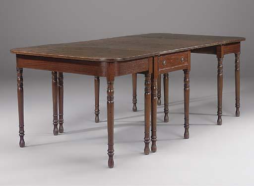 A MAHOGANY DINING TABLE
