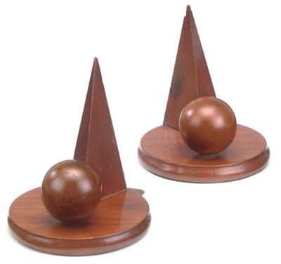 A PAIR OF MAHOGANY BOOKENDS
