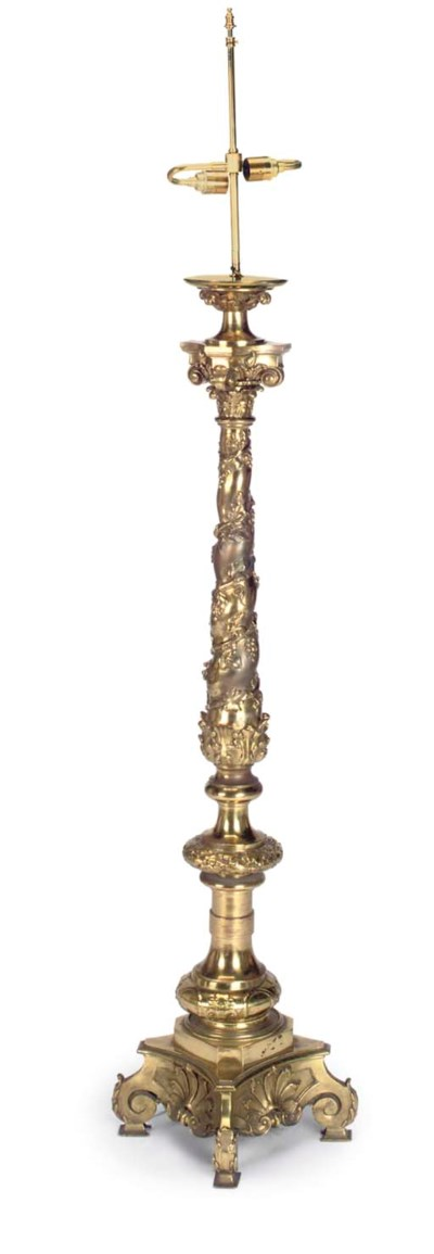 A BRASS FLOOR STANDING LAMP
