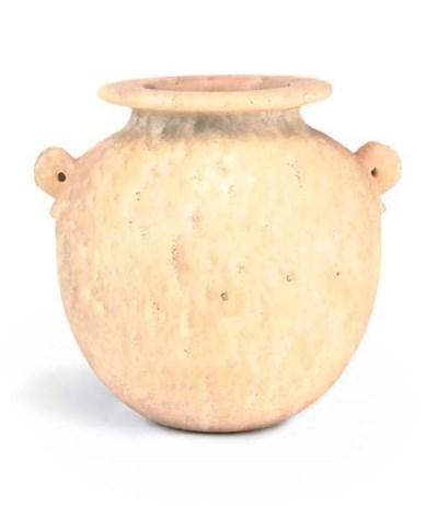 AN EGYPTIAN ALABASTER OIL JAR