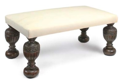 AN OAK AND CALICO-UPHOLSTERED