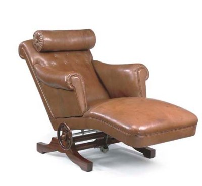 A BROWN LEATHER UPHOLSTERED RE