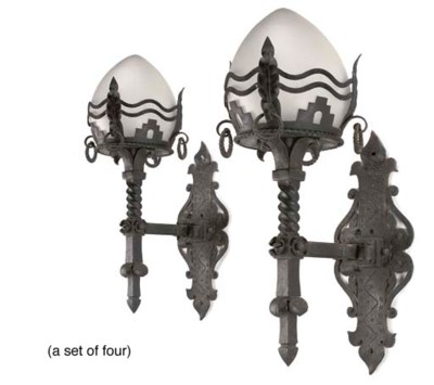 A SET OF FOUR WROUGHT-IRON WAL