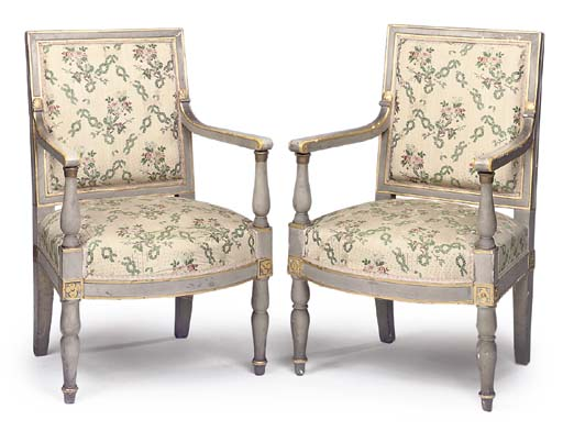 A MATCHED PAIR OF EMPIRE GREY PAINTED AND PARCEL GILT FAUTEUILS