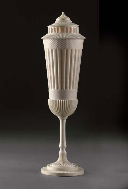 AN ENGINE-TURNED IVORY STANDING CUP AND COVER