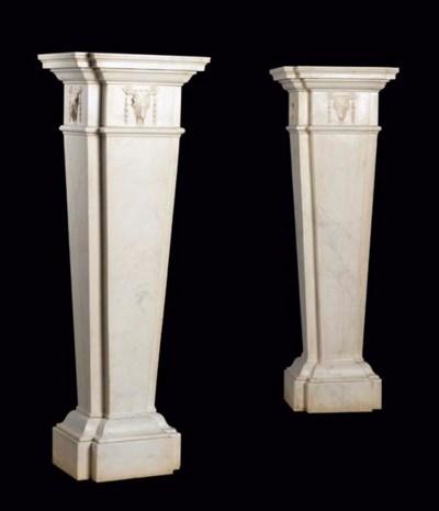 A pair of white marble pedesta