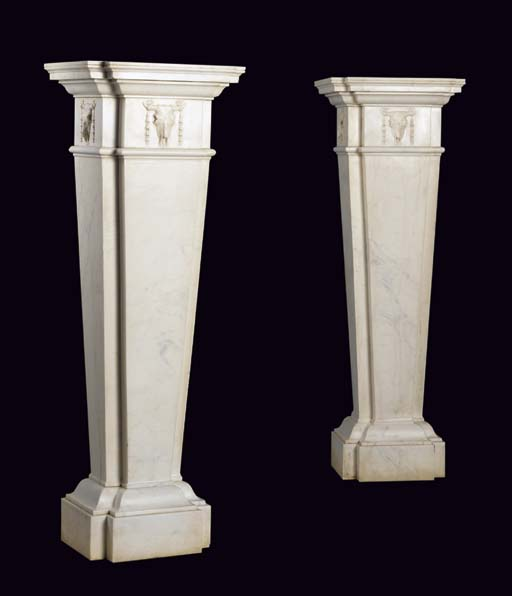 A pair of white marble pedestals