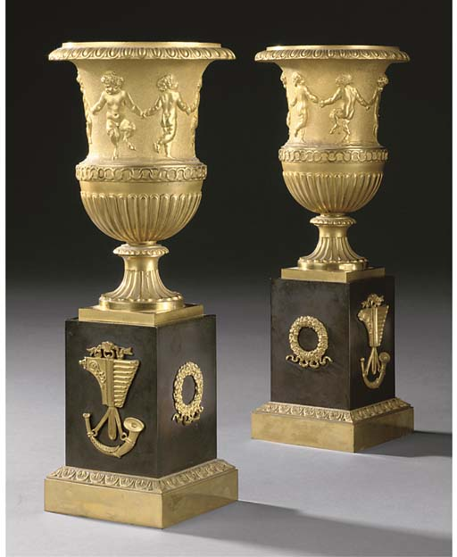 A PAIR OF EMPIRE GILT AND PATINATED BRONZE URNS