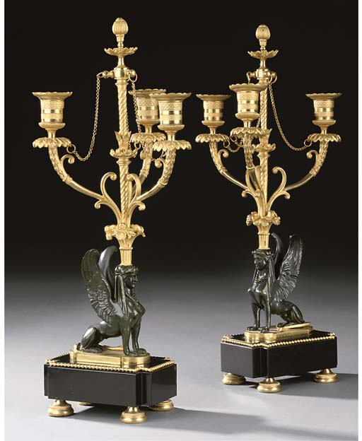 A PAIR OF FRENCH GILT AND PATINATED BRONZE THREE-LIGHT CANDELABRA