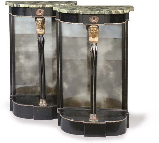 A PAIR OF REGENCY REVIVAL GILT-METAL-MOUNTED EBONISED CONSOLE TABLES