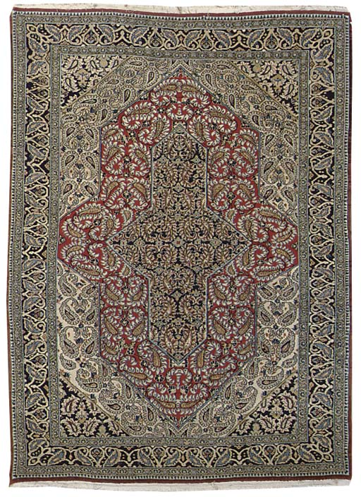 A fine Qum rug and Ardebil rug