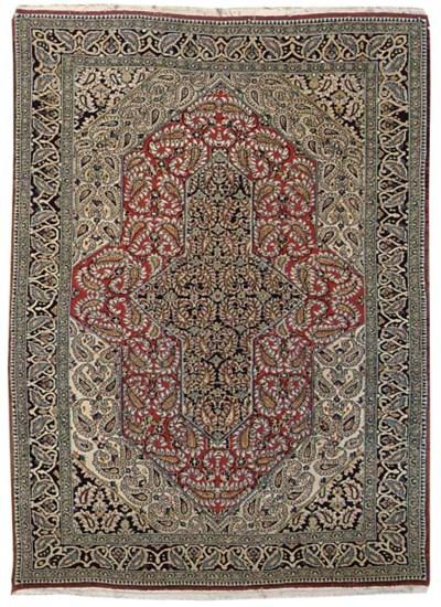 A fine Qum rug and Ardebil rug