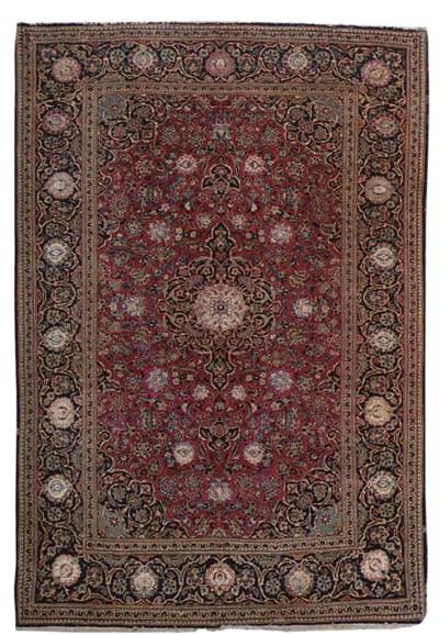 A fine part silk Kashan rug