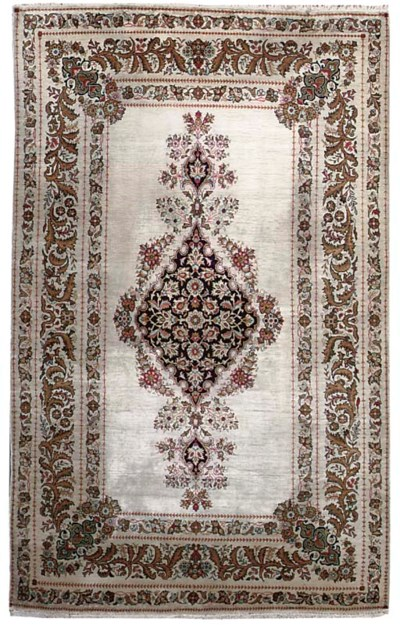 A fine silk Qum rug and part s