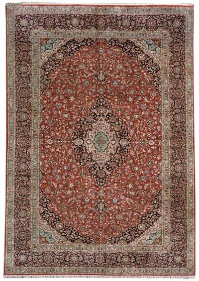 A fine silk Kashan carpet