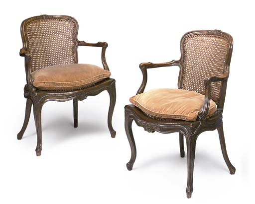 A PAIR OF BEECH CANED FAUTEUIL