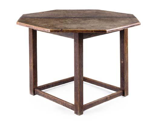 AN OCTAGONAL OAK LOW TABLE