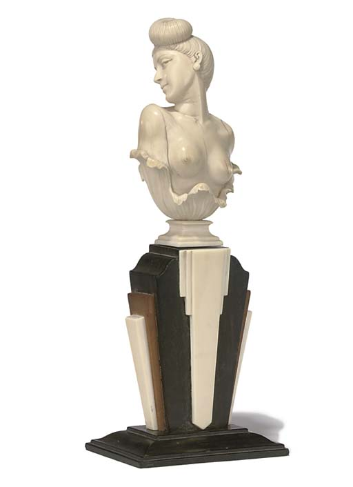 AN ART DECO IVORY BUST OF A WO