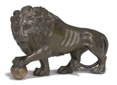 A BRONZE MODEL OF A LION