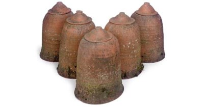 A SET OF FIVE TERRACOTTA RHUBA