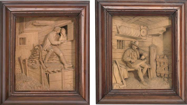 A pair of south german or austrian relief carved soft wood