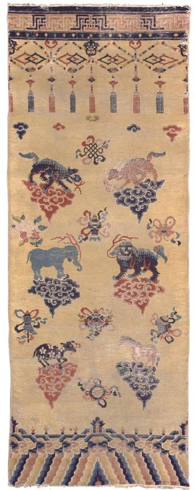 An antique Chinese pillar rug